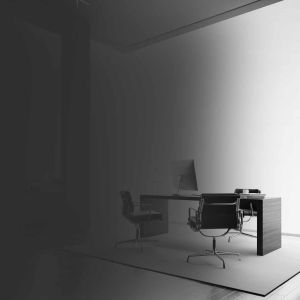 Businessman stands in modern office with one empty canvas. Black and white