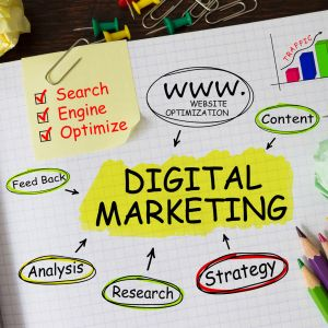 Notebook with Tools and Notes About Digital Marketing